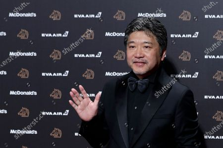 Hirokazu Koreeda poses for photographs at the 56th Golden Horse Awards ceremony in Taipei, Taiwan, 23 November 2019. The film awards established in 1962 are presented to filmmakers working in Chinese-language cinema.