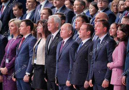 Chairman of the Supreme Council of United Russia Boris Gryzlov (4-L), Russian President Vladimir Putin (C) and Russian Prime Minister Dmitry Medvedev (4-R) listen to the National Anthem, during opening ceremonies of the XIX United Russia Party Congress in Moscow, Russia, 23 November 2019. The pro-Kremlin party United Russia is the main ruling political party in the country.