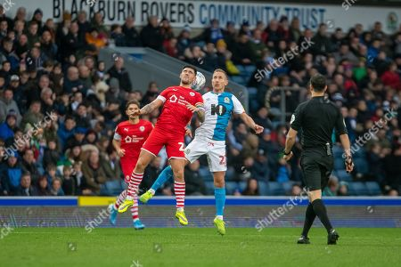 Stock Picture of Lewis Holtby of Blackburn Rovers and Alex Mowatt of Barnsley FC compete for the ball during the EFL Sky Bet Championship match between Blackburn Rovers and Barnsley at Ewood Park, Blackburn