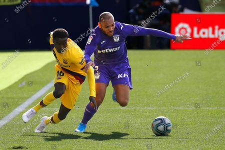 FC Barcelona's Moussa Wague (L) in action against Leganes' Martin Braithwaite (R) during the Spanish La Liga soccer match between CD Leganes and FC Barcelona at Butarque stadium in Leganes, near Madrid, Spain, 23 November 2019.