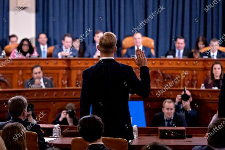 Stock Picture of David Holmes, counselor for political affairs at the United States Embassy in Ukraine, is sworn-in to a US House Intelligence Committee impeachment inquiry hearing in Washington, D.C., U.S.,. The committee heard from nine witnesses in open hearings this week in the impeachment inquiry into US President Donald J. Trump
