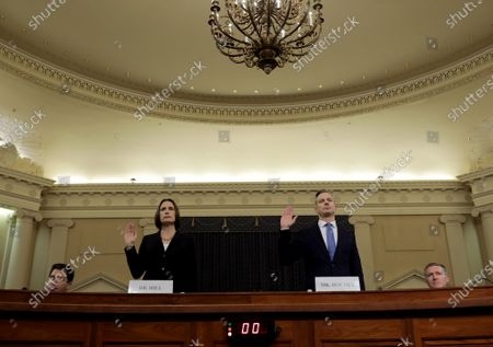 Fiona Hill (L), the National Security Councils former senior director for Europe and Russia, and David Holmes(R), an official from the American Embassy in Ukraine, are sworn in to testify before the United States House Intelligence Committee