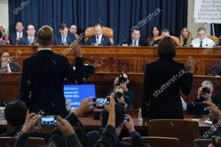 David A. Holmes, Department of State political counselor for the United States Embassy in Kyiv, Ukraine and Dr. Fiona Hill, former National Security Council senior director for Europe and Russia are sworn in as they appear before the US House Intelligence Committee during an impeachment inquiry hearing