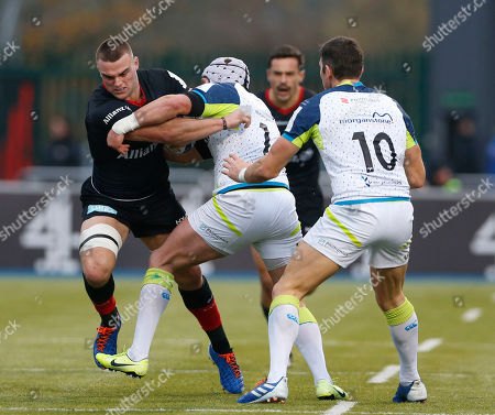 Ben Earl of Saracens is tackled by Tom Williams of Ospreys