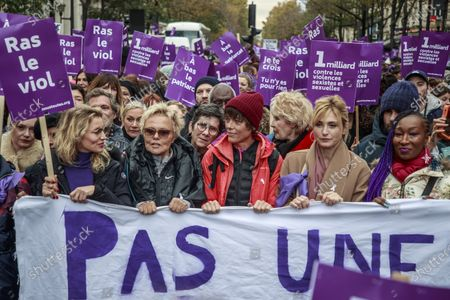 Women rights activists and French actresses Alexandra Lamy (L), Muriel Robin (2-L) and companion of the former French President Julie Gayet (2-R) hold  placards with Purple signs adopted by the feminist movement 'Nous Toutes' (All of Us) as they march during a rally against femicide, gender-based violence and sexual harassment against women, in Paris, France, 23 November 2019.