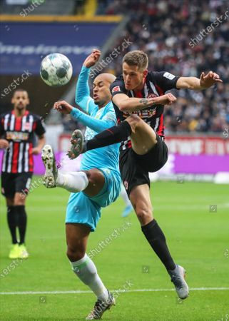 Stock Picture of Wolfsburg's Marcel Tisserand (L) in action against Frankfurt's Erik Durm (R) during the German Bundesliga soccer match between Eintracht Frankfurt and VfL Wolfsburg in Frankfurt Main, Germany, 23 November 2019.