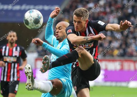 Stock Photo of Wolfsburg's Marcel Tisserand (L) in action against Frankfurt's Erik Durm (R) during the German Bundesliga soccer match between Eintracht Frankfurt and VfL Wolfsburg in Frankfurt Main, Germany, 23 November 2019.