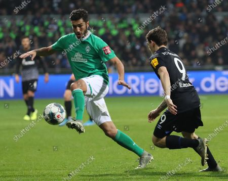 Bremen's Nuri Sahin (L) in action against Schalke's Benito Raman  (R) during the German Bundesliga soccer match between SV Werder Bremen and FC Schalke 04 in Bremen, Germany, 23 November 2019.