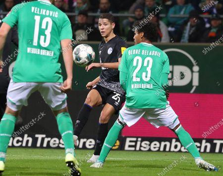 Schalke's Amine Harit (2-R) scores the 0-1 goal during the German Bundesliga soccer match between SV Werder Bremen and FC Schalke 04 in Bremen, Germany, 23 November 2019.