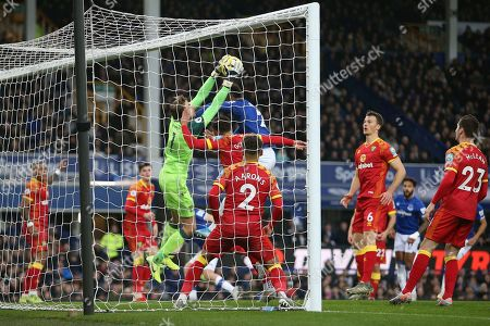 Norwich City goalkeeper Tim Krul (1) plucks the ball off the head of Everton defender Mason Holgate (2) during the Premier League match between Everton and Norwich City at Goodison Park, Liverpool