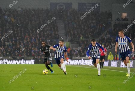 Ricardo Pereira of Leicester City is chased down by Brighton players.