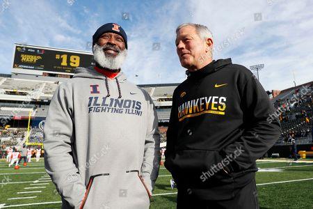 Illinois head coach Lovie Smith, left, talks with Iowa head coach Kirk Ferentz before an NCAA college football game, in Iowa City, Iowa