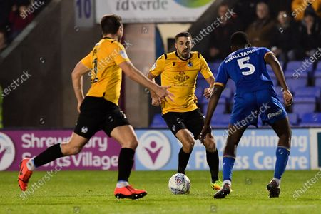 Stock Image of Liam Sercombe of Bristol Rovers is marked by Ro-Shaun Williams of Shrewsbury Town