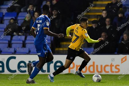 Tyler Smith of Bristol Rovers is marked by Ro-Shaun Williams of Shrewsbury Town