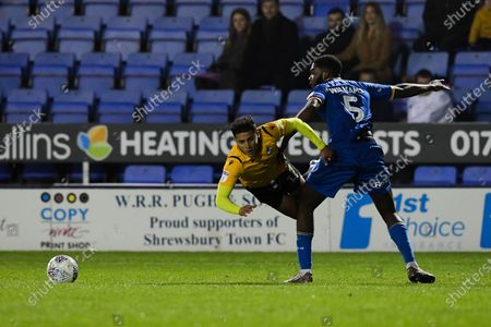 Tyler Smith of Bristol Rovers is challenged by Ro-Shaun Williams of Shrewsbury Town