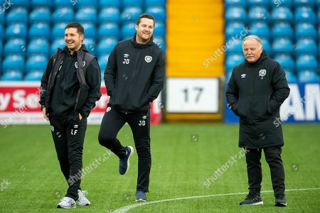 Stock Picture of (LtoR) Heart of Midlothian coaches Liam Fox, Jon Daly and Donald Park on the pitch before the Ladbrokes Scottish Premiership match between Kilmarnock FC and Heart of Midlothian FC at Rugby Park, Kilmarnock