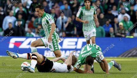 Stock Picture of Betis' midfielder Andres Guardado (L) in action against Valencia's winger Daniel Wass (C) during the Spanish LaLiga soccer match between Real Betis and Valencia CF at Benito Villamarin stadium in Seville, Andalusia, Spain, 23 November 2019.