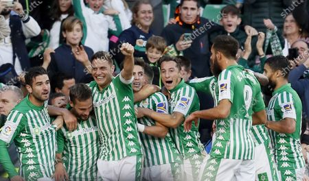 Betis' midfielder Sergio Canales (2-L) celebrates with his teammates after scoring the 2-1 during the Spanish LaLiga soccer match between Real Betis and Valencia CF at Benito Villamarin stadium in Seville, Andalusia, Spain, 23 November 2019.