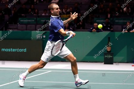 Britain tennis player Daniel Evans in action against Spanish Rafa Nadal during the second match of the Davis Cup's semifinal between Spain and Great Britain at Caja Magica stadium in Madrid, Spain on 23 November 2019.