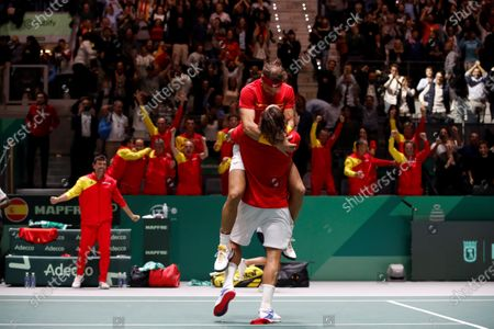 Spanish tennis players Rafa Nadal (L) and Feliciano Lopez celebrate after their win against British Jamie Murray and Neal Skupski during the third double match of the Davis Cup's semifinal between Spain and Great Britain at Caja Magica stadium in Madrid, Spain on 23 November 2019.