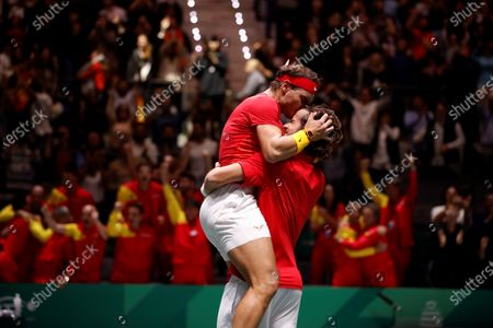 Spanish tennis players Rafa Nadal (L) and Feliciano Lopez celebrated after win against British Jamie Murray and Neal Skupski during the third double match of the Davis Cup's semifinal between Spain and Great Britain at Caja Magica stadium in Madrid, Spain on 23 November 2019.
