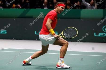 Stock Picture of Spanish tennis players Rafa Nadal in action against British Jamie Murray and Neal Skupski during the third double match of the Davis Cup's semifinal between Spain and Great Britain at Caja Magica stadium in Madrid, Spain on 23 November 2019.