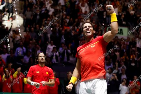 Stock Photo of Spanish tennis player Rafa Nadal celebrated after win against British Jamie Murray and Neal Skupski during the third double match of the Davis Cup's semifinal between Spain and Great Britain at Caja Magica stadium in Madrid, Spain on 23 November 2019.