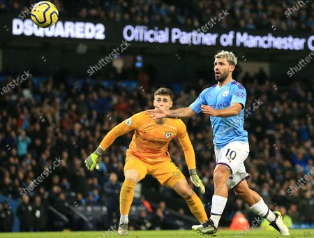 Manchester City's Sergio Aguero (R) in action against Chelsea goalkeeper Kepa Arrizabalaga (L) during the English Premier League match between Manchester City and Chelsea in Manchester, Britain, 23 November 2019.