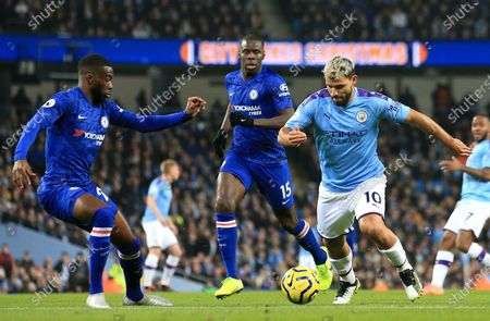Manchester City's Sergio Aguero (R) in action against Chelsea's Fikayo Tomori (L) and Kurt Zouma (C) during the English Premier League match between Manchester City and Chelsea in Manchester, Britain, 23 November 2019.