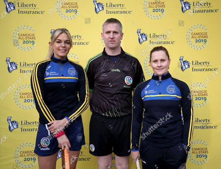 2018 Team vs 2019 Team. 2019's Sarah Dervan with Referee Ray Kelly and Aoife Murray of the 2018 team