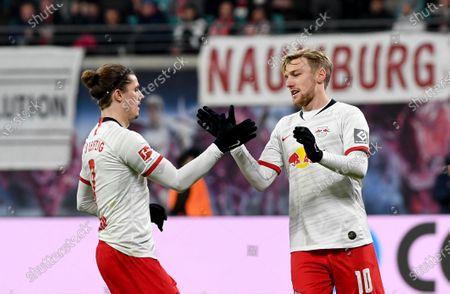 Leipzig's Emil Forsberg (R) celebrates after scores with Leipzig's Marcel Sabitzer during the German Bundesliga soccer match between 1. RB Leipzig vs FC Koeln in Leipzig , Germany,  23 November 2019.