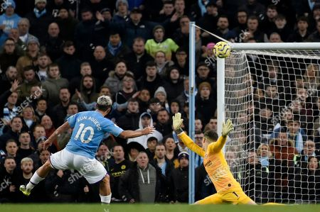 Manchester City's Sergio Aguero, left, misses a chance to score past Chelsea's goalkeeper Kepa Arrizabalaga during the English Premier League soccer match between Manchester City and Chelsea at Etihad stadium in Manchester, England