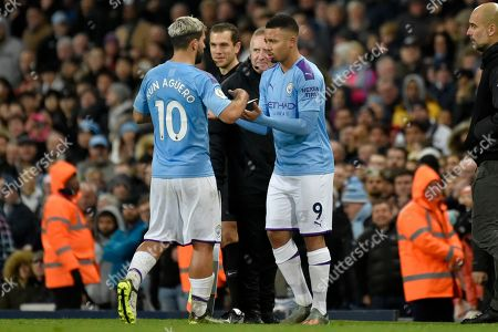Manchester City's Sergio Aguero, left, is replaced by Manchester City's Gabriel Jesus after getting injured during the English Premier League soccer match between Manchester City and Chelsea at Etihad stadium in Manchester, England