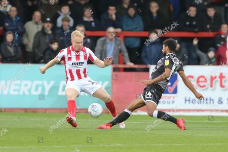 Stock Picture of Ryan Broom and Brandon Comley  during the EFL Sky Bet League 2 match between Cheltenham Town and Colchester United at Jonny Rocks Stadium, Cheltenham