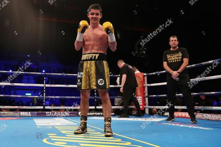 Stephen Smith celebrates at the end of the fight