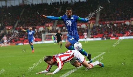Stoke City defender Stephen Ward (3) is fouled by Wigan Athletic defender Nathan Byrne (2) during the EFL Sky Bet Championship match between Stoke City and Wigan Athletic at the Bet365 Stadium, Stoke-on-Trent