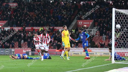 Stoke City striker Mame Biram Diouf (18) scores during the EFL Sky Bet Championship match between Stoke City and Wigan Athletic at the Bet365 Stadium, Stoke-on-Trent