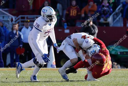 Iowa State linebacker Will McDonald, right, sacks Kansas quarterback Carter Stanley, center, as Kansas offensive lineman Hakeem Adeniji, left, comes into help during the second half of an NCAA college football game, in Ames, Iowa. Iowa State won 41-31
