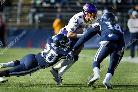 Stock Photo of East Carolina wide receiver Blake Proehl (11) is taken down by Connecticut defensive back Robert King III (20) during the first half of an NCAA college football game, in East Hartford, Conn