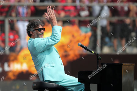 Stock Image of Argentinian singer Fito Paez performs prior to the Copa Libertadores final soccer match between Brazil's Flamengo and Argentina's River Plate at the Monumental stadium in Lima, Peru