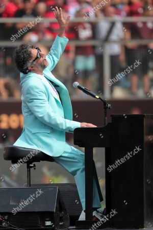 Argentinean singer Fito Paez performs prior to the Copa Libertadores final soccer match between Brazil's Flamengo and Argentina's River Plate at the Monumental stadium in Lima, Peru