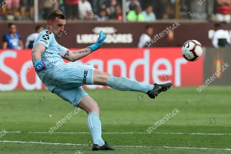 Franco Armani, goalkeeper of Argentina's River Plate, kicks the ball during the Copa Libertadores final soccer match against Brazil's Flamengo at the Monumental stadium in Lima, Peru