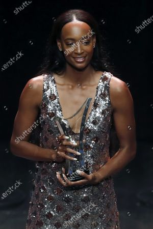 World 400m hurdles champion Dalilah Muhammad of USA poses with her Female Athlete of the Year award during the IAAF Athletes of the Year Award Ceremony at the Grimaldi Forum in Monaco, 23 November 2019.