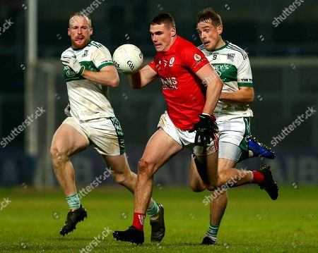 Portlaoise (Laois) vs Eire Og (Carlow). Portlaoise's Ciaran McEvoy and Kieran Lillis and Jordan Morrissey of Eire Og