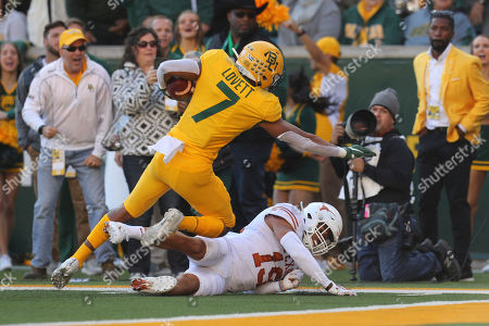 Stock Image of Baylor running back John Lovett (7) falls over Texas defensive back Brandon Jones (19) on a touchdown run in the first half of an NCAA college football game, in Waco, Texas