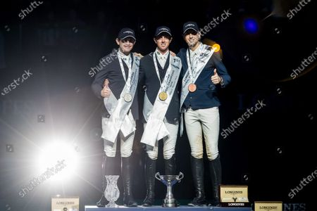 (L-R) Second placed Darragh Kenny of Ireland, winner Ben Maher of Britain and third placed Martin Fuchs of Switzerland on podium after the Longines Global Champions Tour Super Grand Prix competition in Prague, Czech Republic, 23 November 2019.
