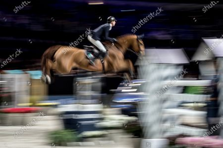 Stock Photo of Ben Maher of Great Britain rides his horse 'Explosion W' during the Longines Global Champions Tour Super Grand Prix competition in Prague, Czech Republic, 23 November 2019.