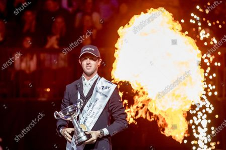 Ben Maher of Britain holds trophy as he celebrates winning the Longines Global Champions Tour Super Grand Prix competition in Prague, Czech Republic, 23 November 2019.