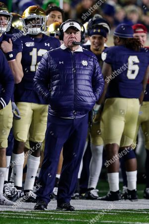Notre Dame head coach Brian Kelly watches his team from the sideline as they play against Boston College during the second half of an NCAA college football game in South Bend, Ind., . Notre Dame defeated Boston College 40-7