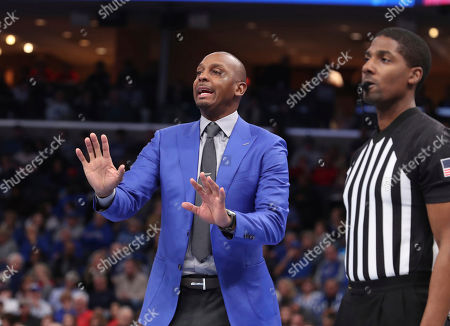 Memphis' head coach Penny Hardaway calls to his players in the second half of an NCAA college basketball game against Ole Miss, in Memphis, Tenn